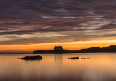 Porth Cwyfan, in Anglesey, at dusk