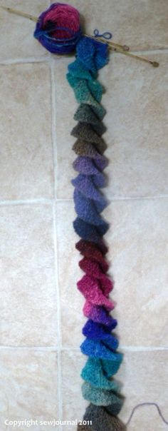 """spiral scarf knitting & crochet patterns with links. Check the """"How to knit a spiral scarf"""" & the Washington Post pattern. Each one is knitted lengthwise, but 1 uses a YO increase, & the other uses an increase by knitting the same stitch Both sound FUN! Knit Or Crochet, Crochet Scarves, Crochet Crafts, Yarn Crafts, Crochet Stitches, Sewing Crafts, Diy Crafts, Knitting Scarves, Free Crochet"""