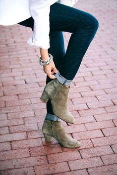 Cuffed dark denim and suede ankle boots.