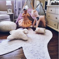 Our Angel Wings machine washable rug is a gorgeous addition to any nursery decor. Made with 100% non-toxic materials, a portion of proceeds goes to building schools in India. Visit Lorenacanals.com for more children's room decorating ideas and to shop our stylish baby rugs.
