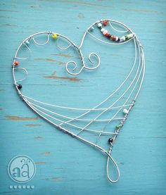 decorating with beads and wire | Heart Wire Ornament with Beads Playful and Delicate by artsyants