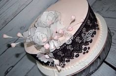 Black cake lace and sequins, pearls, wafer paper flowers and butterflies. Elegant pink and black cake