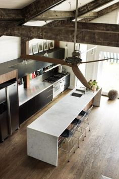 wonderful kitchen but what i cannot get over is the solid cut white carrara marble island with inlaid teak wood cladding.