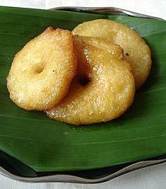 Festive food... Bellam Garelu (Lentil Doughnuts soaked in molasses syrup)