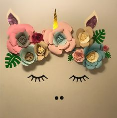 Decorate your child's room beautifully with this unicorn face wall unit. This is a kit that consists of large 3D flowers in various sizes, eyelashes, nostrils, a horn, and leaves made of vinyl; and...