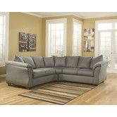 Found it at Wayfair - Harvest Sectional  The cafe color (dark brown) with the greenish-grey walls might suit the room...