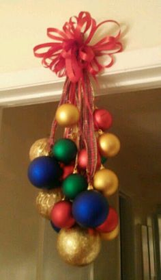 """this would look really cute with bright colored ornaments we could Hang them from our living room entry so we can see/appreciate our """"work of art"""" .with just christmas colors red green gold though All Things Christmas, Winter Christmas, Christmas Home, Christmas Wreaths, Merry Christmas, Christmas Ornaments, Red Ornaments, Christmas Ribbon, Christmas Projects"""