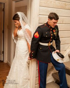 """U.S. Marine Corps Cpl. Caleb Earwood and his bride Maggie had a heartwarming moment before their wedding ceremony last Saturday, May 23rd. With it being Memorial Day weekend, this touching exchange couldn't have been more perfect. Caleb held Maggie's hand while saying a prayer for their marriage and their lives together, careful not to see her around the doorway before she walked down the aisle. ~ The picture has gone viral and been loved all over the world. It's been featured on Fox and Friends, ABC News, The Today Show, Good Morning America, Fox News and numerous local news stations nationwide ~ Dwayne Schmidt Photography captured the image and Dwayne says """"I was lucky to witness such a moving moment let alone capture it. I have been fortunate enough to photograph several weddings, but this is a moment I will remember forever."""" Read more about this couple here: http://www.wlos.com/news/features/top-stories/stories/asheville-wedding-photo-goes-viral-21222.shtml#.VWTSk09VhBf"""