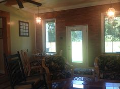 Back door. All windows are Pella with blinds between panes. Doors also have blinds between panes.