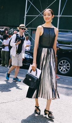Fei Fei Sun in a full Proenza Schouler look. On the street at New York Fashion Week. Photographed by Phil Oh.