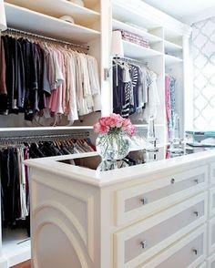 simple white closet, love the wallpaper
