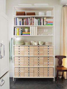 """Save Space  """"When space is at a premium, invest in a large, one-stop-shop bookcase that will serve multiple storage needs. Place it in a central location in your apartment unit and store books and dishes on the upper shelves; place bins, baskets, or drawers on the lower shelves to house linens, flatware, and any extra things that don't have a place to live."""""""