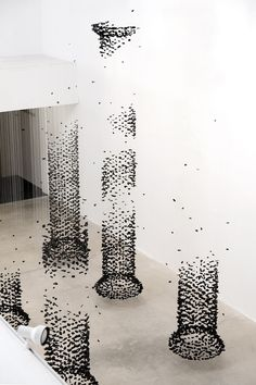 Seoul-based artist Seon Ghi Bahk - delicate columns of suspended charcoal #art #installation