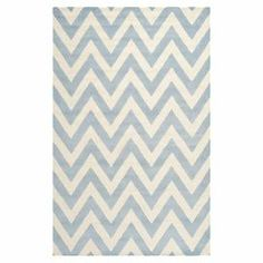 """Anchor your living room seating group or define space in the den with this artfully hand-tufted wool rug, featuring a chevron motif for eye-catching appeal.  Product: RugConstruction Material: WoolColor: Light blue and ivoryFeatures:   Chevron motifHand-tuftedMade in IndiaPile Height: 0.63"""" Note: Please be aware that actual colors may vary from those shown on your screen. Accent rugs may also not show the entire pattern that the corresponding area rugs have.Cleaning and Care: Professional ....."""