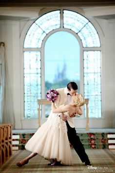 Romance at its finest set against the backdrop of a picturesque window with a view of Cinderella Castle #Disney #wedding #photography #WeddingPavilion