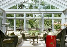 Although my dream is a rustic log cabin home, I have been dreaming of a greenhouse porch like this. All windows with antique white trip and victorian decor.    Greenwich Barn Home   Heritage Restorations