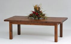 Handcrafted rustic farmhouse tables made from distressed reclaimed barn wood available in custom sizes in the USA, America. Naturally aged salvaged old woods.