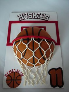 A basketball cake for Benjamin, 11 years old. He plays basketball and loves it. This is a marble cake with creamcheese filling all covered w...