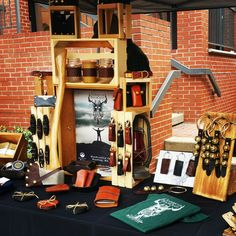 Sleigh Bell Door Hangs, Cast Iron Pan Holders, Coasters, Wool Hats & Gloves, 'Coffee Before Chaos' Leather Mug Wraps, 'Bottoms Up' Leather Mason Jar Wraps and more Made in the USA goods by American Bench Craft at Salem, MA Open Market in Derby Square