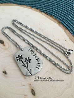 Just Breathe  Hand Stamped Flower Necklace by JessicaBe on Etsy
