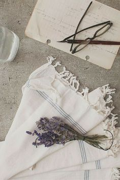Odi white simple linens with a pop of blue can be used as napkins with a minimal, raw style or as a farmhouse style dish towel.
