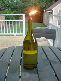Wine Bottle Citronella Candle -- you could also fill the bottom of the bottle with small stones or sand to take up space and add weight so it won't tip over as easily.  ***Can't wait to try this***
