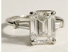 Jewelry Diamond : The perfect engagement ring: A simple emerald cut diamond framed by baguettes. - Buy Me Diamond Angelina Jolie Engagement Ring, Perfect Engagement Ring, Engagement Ring Cuts, Solitaire Engagement, Wedding Engagement, Bling Bling, The Bling Ring, Diamond Rings, Diamond Jewelry