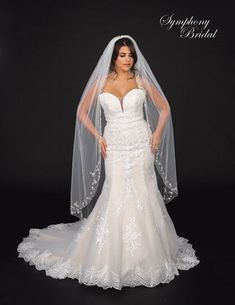 This romantic Waltz Length Wedding Veil with Floral Design Symphony Bridal 7148VL will beautifully complement your bridal gown.
