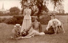 Group on the grass with their dogs  by Libby Hall Dog Photo, via Flickr