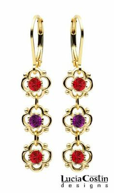 Lever Back Dangle Earrings by Lucia Costin with 4 Petal Flowers Surrounded by Dots, Red, Purple Swarovski Crystals; .925 Sterling Silver with 24K Yellow Gold Plated Lucia Costin. $36.00. Garnished with light-siam and violet Swarovski crystals. Lucia Costin dangle earrings. Unique and feminine, perfect to wear for special occasions and evenings. Create a delicate and romantic look. Produced delicately by hand, made in USA