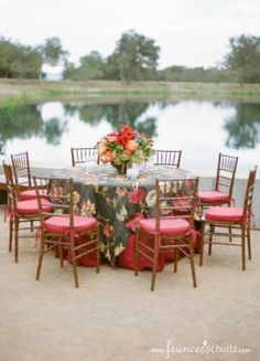 Autumn Outdoor Wedding at Rancho La Zaca. Embroidered tablecloths in rich fall jewel tones with fruitwood ballroom chairs.