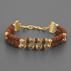 Ethnic wear is an evergreen trend. And similarly, this ethnic Rudraksha bracelet online is also evergreen. With gold plating, it shines in the darkness and in the caves of your heart. Shop for this men's fashion bracelet today. Mens Gold Bracelets, Mens Gold Jewelry, Fashion Bracelets, Fashion Jewelry, Gold Bracelet For Women, Gold Chain Design, Gold Ring Designs, Gold Jewellery Design, Bracelet Designs