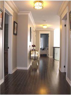 Love the dark flooring! Paint color: Benjamin Moore Revere Pewter