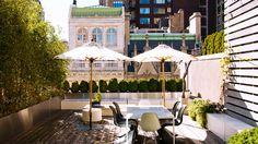 The Most Gorgeous Urban Rooftop Gardens//umbrellas, modern patio