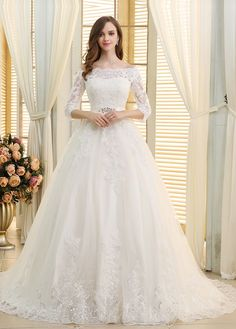 Romantic tulle off-the-shoulder neckline ball gown wedding dresses with beaded sequin lace appliques. Turn his most romantic dream into a reality, as you march down the aisle looking like a fairy tale princess in this wedding dress!