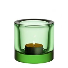 Iittala Kivi Apple Green Tealight Holder from Hus & Hem.  Designed by Heikki Orvola in 1998, Ittala's Kivi tealights are like small colourful jewels of light. The colour and thickness of each votive enriches the glow as it multiplies the flickers of the flame.  With such a wide range of beautiful colours to choose from, you can create a combination for every season and occasion of the year.