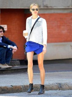 Leather boots, bold micro mini skirt, white shirt, embellished blazer as Ray Bans. Easily duplicated
