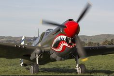 P-40E Warhawk in Flying Tigers livery. Photo taken after its flying display as part of the Vintage Aviator ANZAC air show. - Photo taken at Masterton (- Hood) (MRO / NZMS) in New Zealand on April 27, 2013.