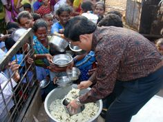 Rev. Joseph Yelchuri gives out food to those in desperate need of nourishment after the devastating floods in India in 2013.