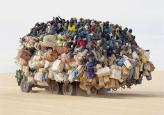 a little bit crowded transport (I love the  there is a guy giving peace hand sign at the top of this chaos on wheels)