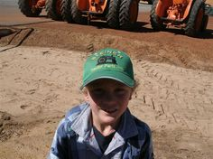 7 year old fan of Steiners and John Deere gets his cap