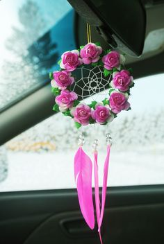 This gorgeous hot pink flower dreamcatcher makes a unique gift, or treat yourself! The perfect size for a cute car dreamcatcher, interior car accessory, car mirror charm, boho nursery decor, or pink nursery decor, this piece has an attached elastic at the top for easy installation over your cars rearview mirror or in a window. With bright pink feathers and Mulberry paper flowers, it is sure to brighten up your space and garner all sorts of compliments! This pink dreamcatcher is completely…