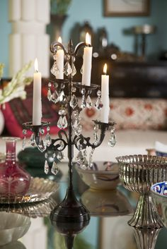 TANJORE CANDELABRA  Classic and antique this candle stand made in brass with black nickel plating, to add drama to any table setting or décor style. Shop the candelabra on our #WebBoutique . #BridalWishlist