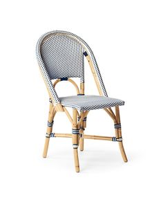 The classic 1930s European bistro chair, reinterpreted. Handcrafted of lightweight rattan and woven plastic seats, our take is fabulously family-friendly and great for the kitchen or the patio. (Just remember to store it indoors when the rains come.) Following a time-honored technique perfected by the French, we've stretched and shaped the frame by hand, creating subtle organic marks on the natural rattan. For added versatility, a slight variation in how the colors are woven make our entire…