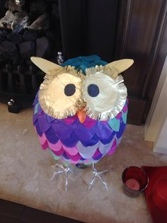 Owl piñata - paper mache around a balloon, decorate with strips of tissue paper cut into wavy shapes and make foil feet!