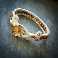 Cool idea....use of button with soutache!  From....S A A D I A