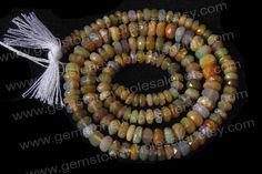 Ethiopian Opal Faceted Roundel Quality B / by GemstoneWholesaler, $39.60