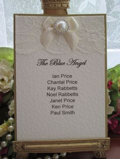 K0010 St Moritz Ivory Lace Satin Pearl Table Plan Card Available from www.vintagelaceweddingcards.co.uk