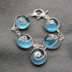 spiral jewel~ So simple & beautiful..perfect so a summer/beach or destination wedding imo