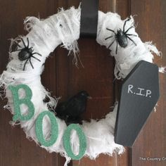 Scary Halloween Wreath Tutorial minus the coffin and add some more spiders and it's awesome